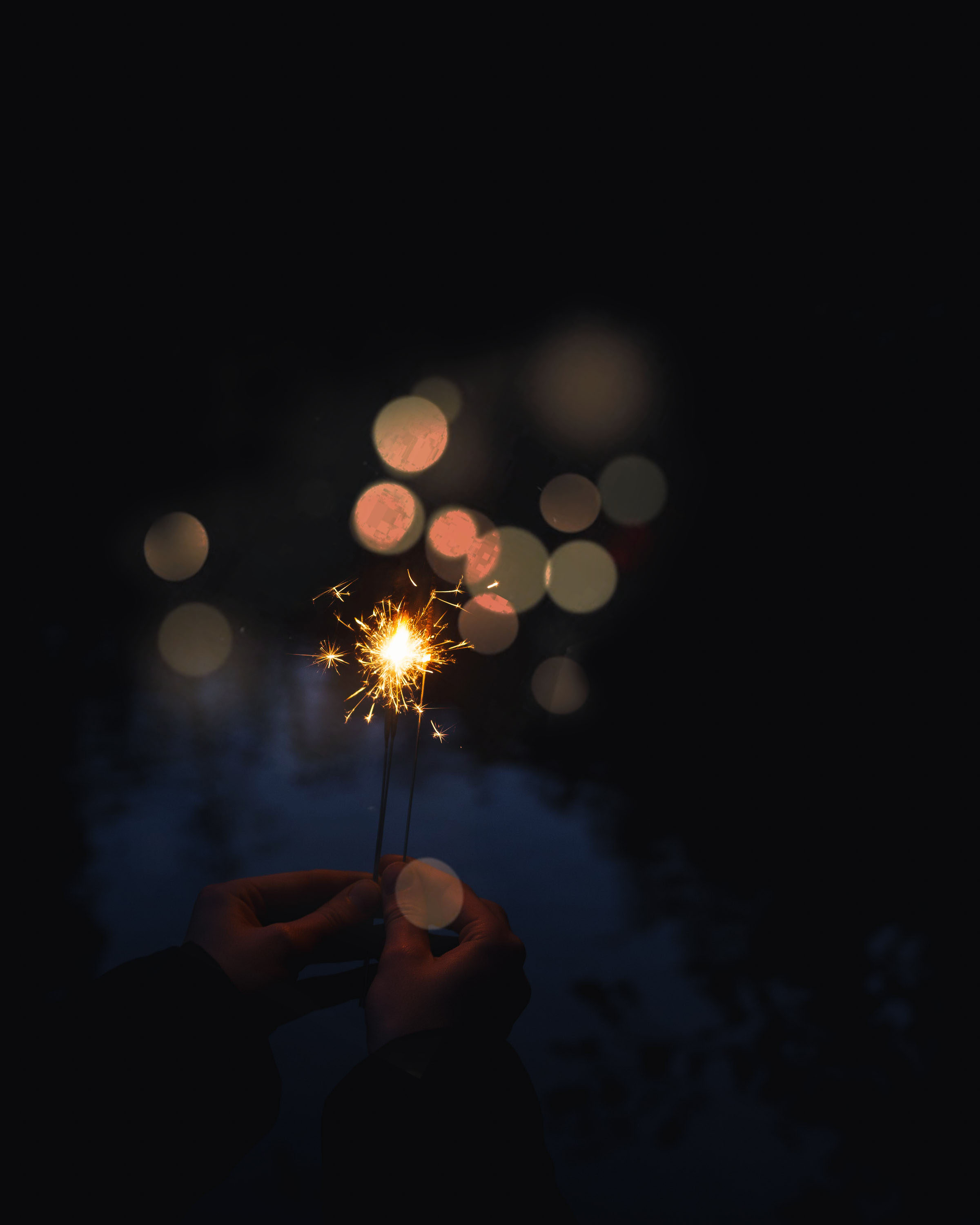 Seasonal rituals November sparkler bokeh