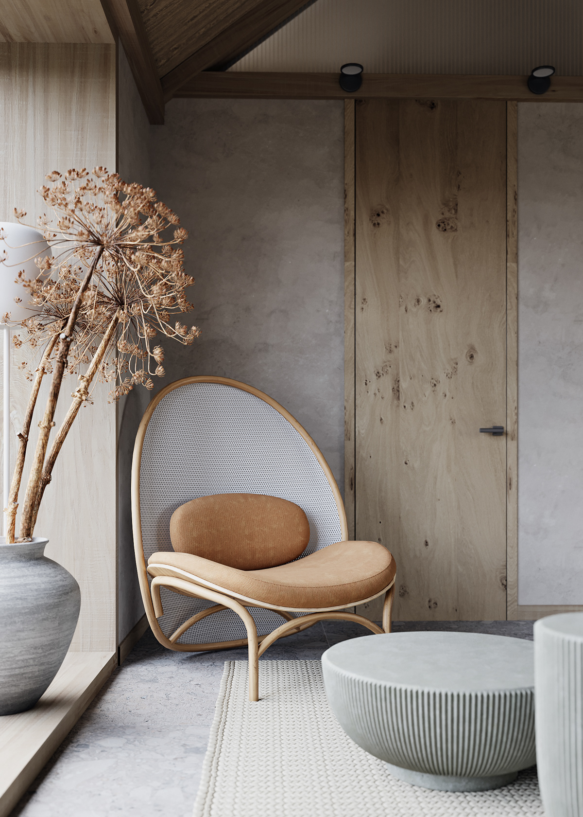 designer chair and tall seed heads sit in a modern space