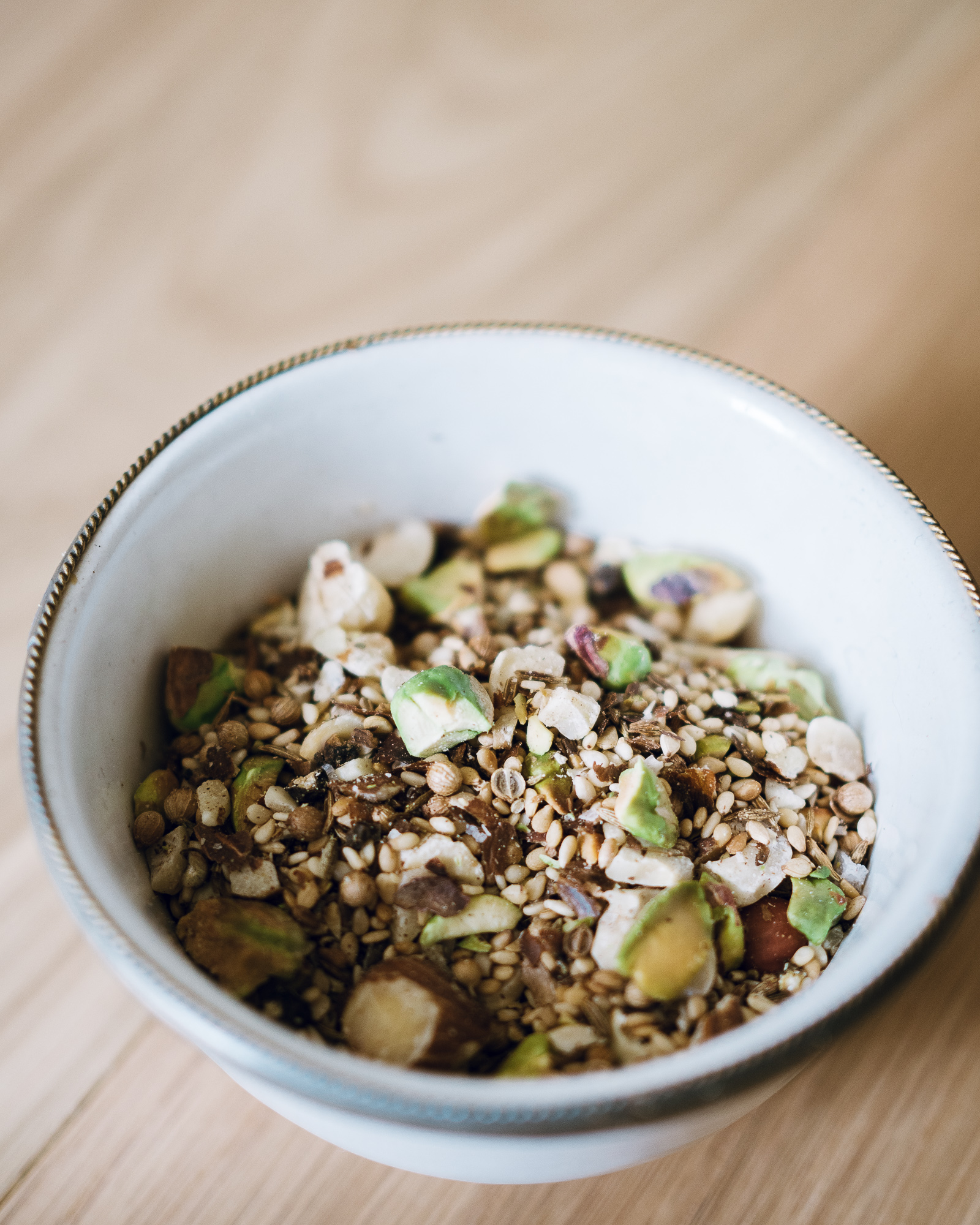 dukkah recipe in small white bowl
